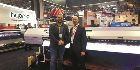 Andrew O'Brien of W.C. O'Brien and Bernard Hoey of Reprocentre with the Mimaki UJV55-320.