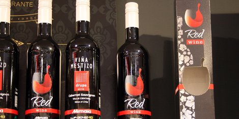 Mimaki's printed bottles looked as good as the wine tasted on its drupa stand.