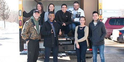 The Orbus team with LCpl Steven Collins, after loading the truck with boxes of donated toys