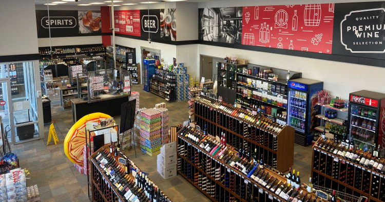 Warwick Printing installed a liquor store wall mural in a single day using Drytac ReTac wall media, despite having to work around shelves full of fragile stock.