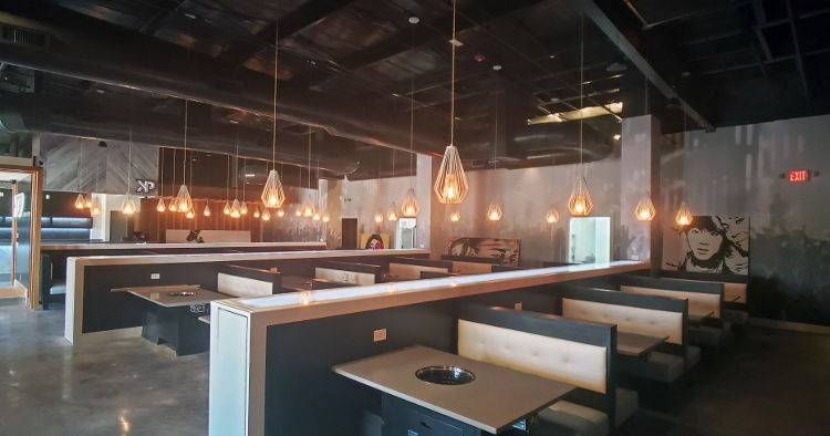 A branch of KPOP, a Korean barbecue restaurant, has a stylish new look thanks to over 6,200 sq. ft of wall graphics printed on Drytac ReTac by High Stakes Creative.
