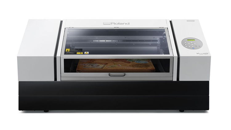 Roland DGA introduces new VersaUV LEF2-300D flatbed UV printer.