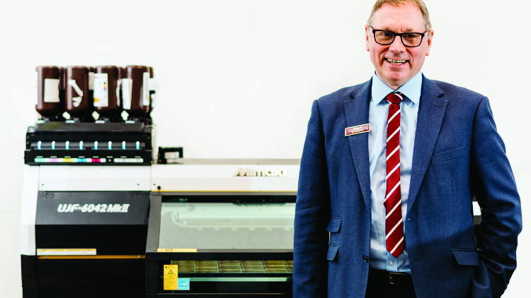 Badgemaster MD, Ian Bradbeer with one the company's new Mimaki UJF MkII LED UV flatbed printers.