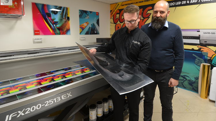 Brent Hardy-Smith (right) put the new Mimaki JFX200-2513EX through its paces with the help of Hybrid's showroom technician, Ashley Carr (left).