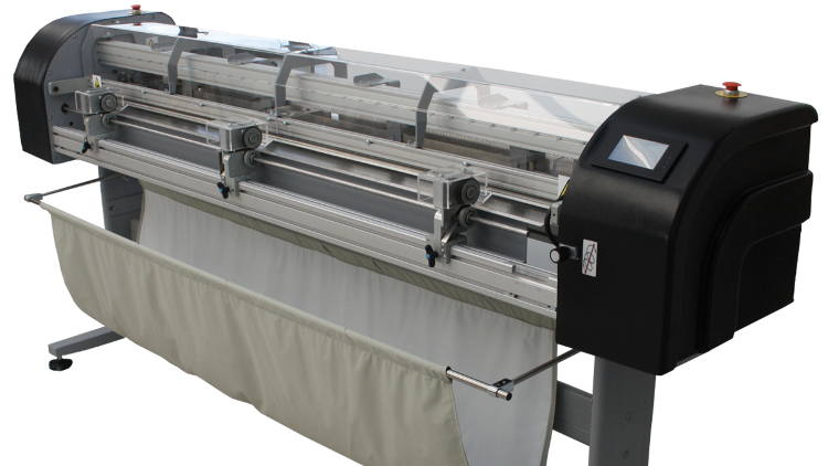 "The KalaXY is a 65"" wide automatic XY trimmer which quickly cuts prints from a roll into sheets providing a significant time saving in poster finishing."