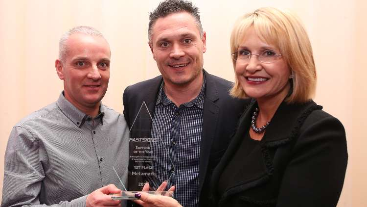 Andy Clay and Marcus Prickett of Metamark and Catherine Monson FASTSIGNS' Global CEO.