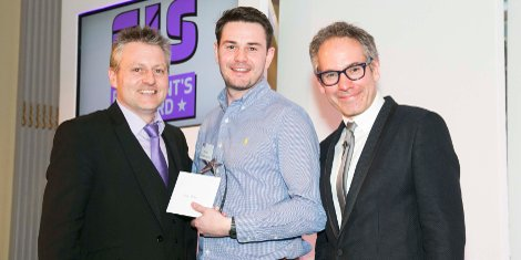 "Andy Parkin (centre) receives his ""Outstanding Employee of the year"" award from FIS President Steve Coley (left) and keynote speaker Dominic Frisby (Financial columnist and comedian)."