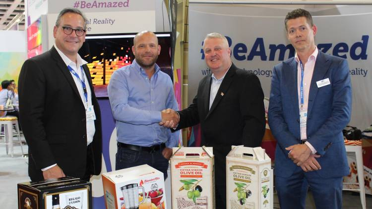 Martin Shipp, Chief Operating Officer of The Delta Group (centre left) at FESPA Global 2018 with EFI's Ken Hanulec (centre right), Frank Mallozzi (far left) and Frank Janssen (far right).
