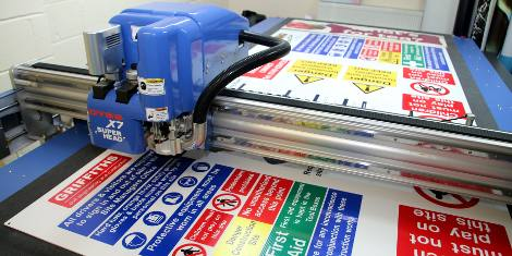 Safety signs being cut on DYSS X7-1325C