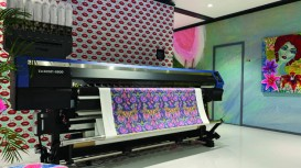 Mimaki hybrid printer demonstration at ITMA 2019 emphasises accessibility of textile printing.